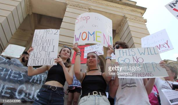 Hundreds of abortion rights advocates rally in front of the Georgia State Capitol in Atlanta to protest new restrictions on abortions that have been...