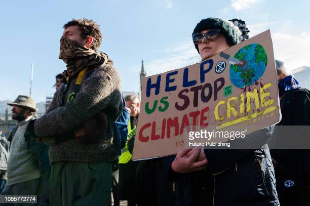 Hundreds of activists and campaigners gather in London's Parliament Square for 'Extinction Rebellion' protest against the inaction of the British...