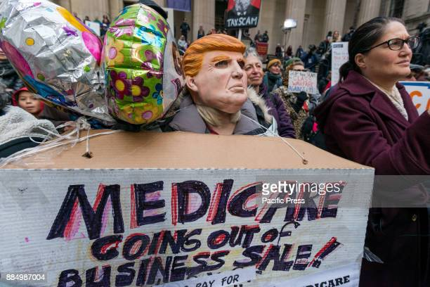 Hundreds of activists held a rally in Foley Square before marching to Wall Street protesting the US Congress' tax bill which was approved by the US...