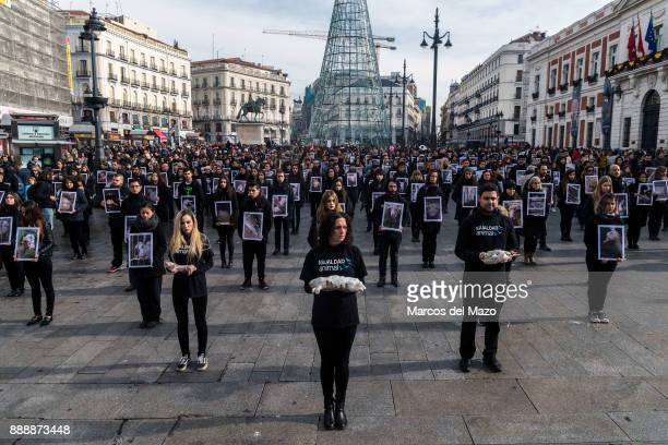 Hundreds of activists of pro-animal rights group 'Igualdad Animal' hold dead animals while others hold pictures of mistreated animals during a...