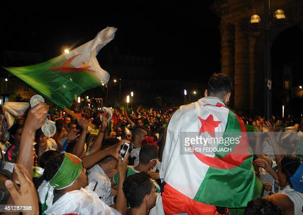 Hundreds of Algerian fans celebrate the historic qualification of Algeria into the second round of the 2014 FIFA World Cup after a 11 draw against...
