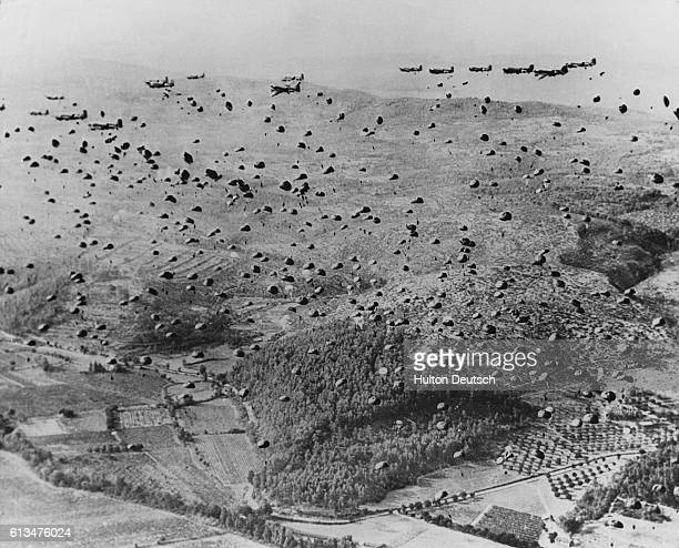 Hundreds of American paratroopers drop into Normandy France on or near DDay June 6 1944 Their landing part of an allout Allied assault from air and...