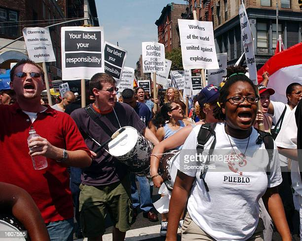 Hundreds of anti sweatshop protesters rally August 7 2001 in New York City The rally was part of a new campaign by UNITE to hold retailers...