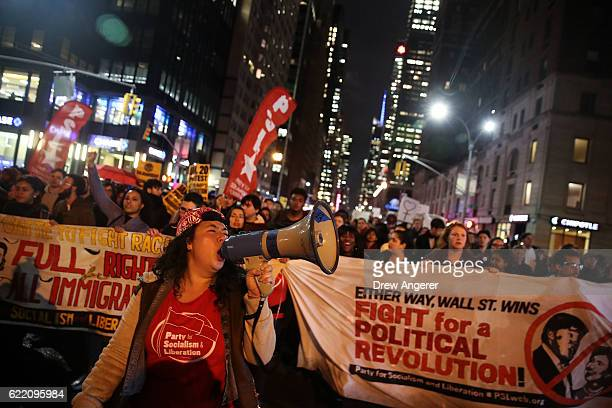 Hundreds of antiDonald Trump protestors march through the street on 6th Avenue on their way to Trump Tower November 9 2016 in New York City...