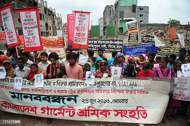 Hundreds of Bangladeshi garment workers and family member of missing workers form a human chain during a protest two months after a ninestorey...