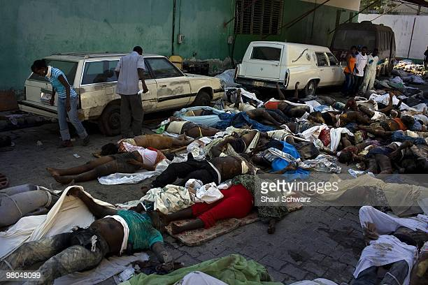 Hundreds of bodies are piled up outside the main morgue in the general hospital of Port Au Prince following a massive 70 earthquake on January 15...