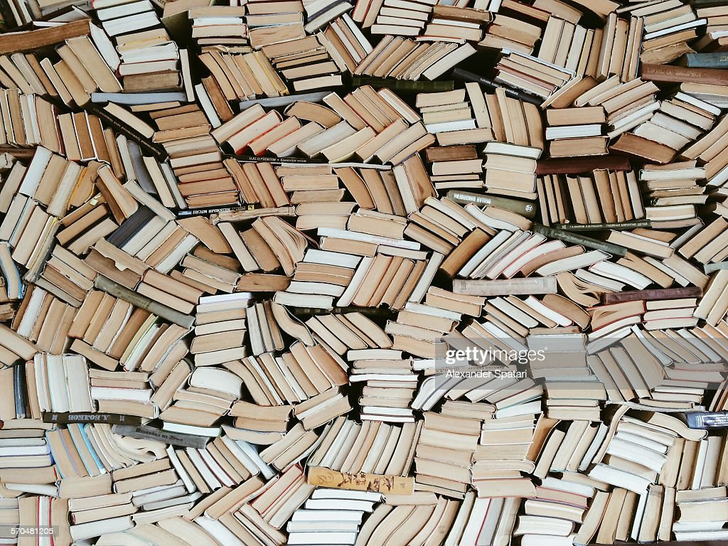 Hundreds of books in chaotic order : Stock Photo