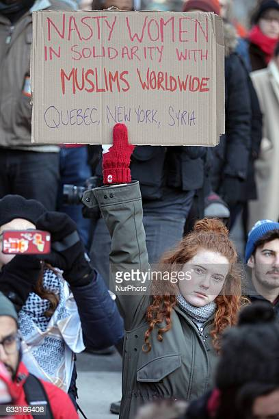 Hundreds of Canadians held a massive protest against President Trump's travel ban outside of the US Consulate in downtown Toronto Ontario Canada on...