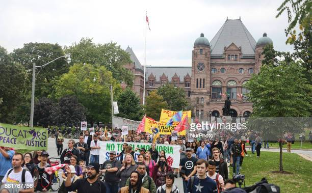 Hundreds of Canadians march during a rally against White Supremacy and Islamophobia at Queen's Park in Toronto Ontario Canada on October 15 2017