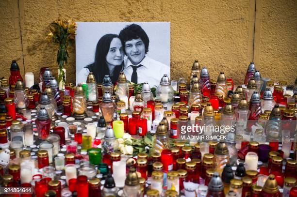 Hundreds of candles have been placed in front of a portrait of Slovak investigative journalist Jan Kuciak and his girlfriend Martina Kusnirova in the...