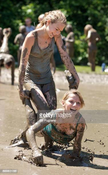 Hundreds of children play in a giant lake of mud at the annual Mud Day event July 7 2009 in Westland Michigan The event is sponsored by the Wayne...