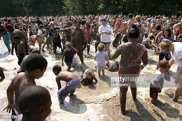 Hundreds of children play in a giant lake of mud during Mud Day at Nankin Park July 10 2007 in Westland Michigan The annual Mud Day event consists of...