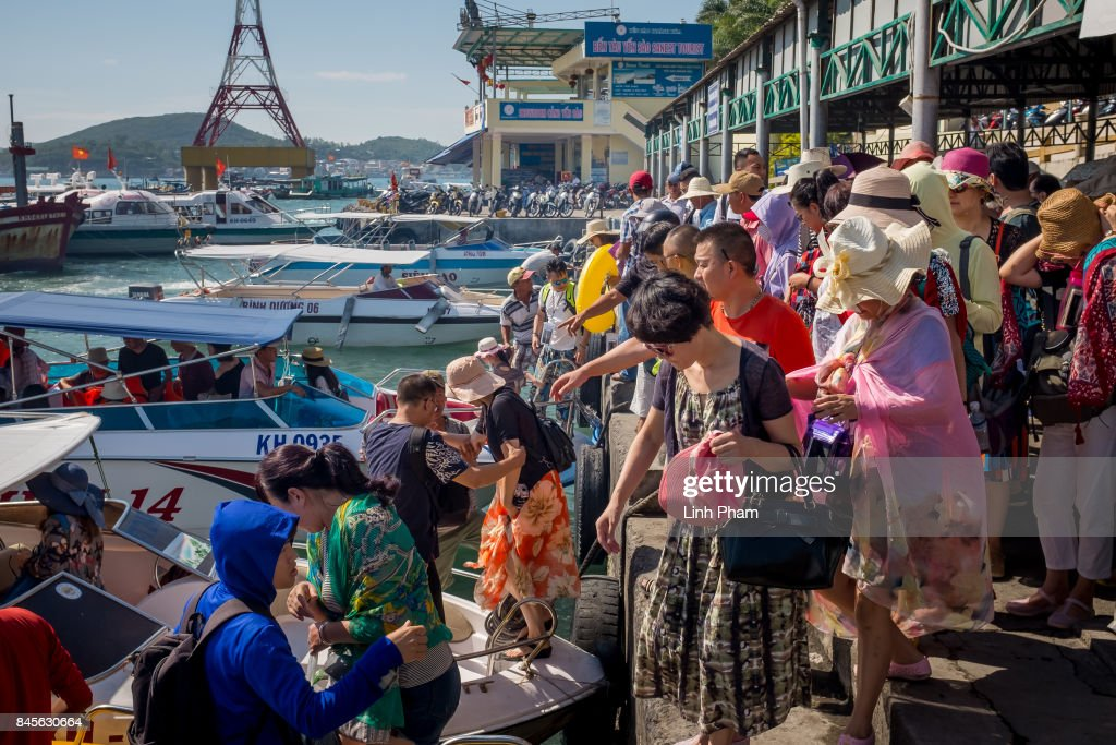 Hundreds of Chinese tourists enter the boats to get to more isolated islands from Cau Da Port on September 10, 2017 in Nha Trang, Vietnam. With a total of 2.7 million tourists in 2016, China is Vietnam's largest source of visitors, as most mainland Chinese head to the coastal cities of Da Nang or Nha Trang located in the centre of the country and famed for their beaches, historical sights and seafood. Based on reports, Chinese tour groups have grown to 150 to 200 while the influx has caused problems such as the lack of Chinese speaking staff and inexperience in dealing with inappropriate behavior by the mainland Chinese who have been criticized for their lack of manners in public spaces, including spitting and urinating in public and being noisy at religious places and heritage sites. As Vietnamese travel agencies aim to improve service for Chinese tourists, local media have reported the illegal use of the Renminbi in local markets and Chinese agents and guides acting without proper authorization, leading to distortions in how Vietnam's history and culture have been presented.