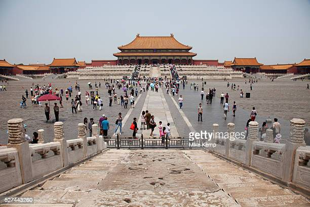 Hundreds of Chinese tourists walk towards the Hall of Supreme Harmony inside The Forbidden City a Chinese imperial palace from the Ming Dynasty to...