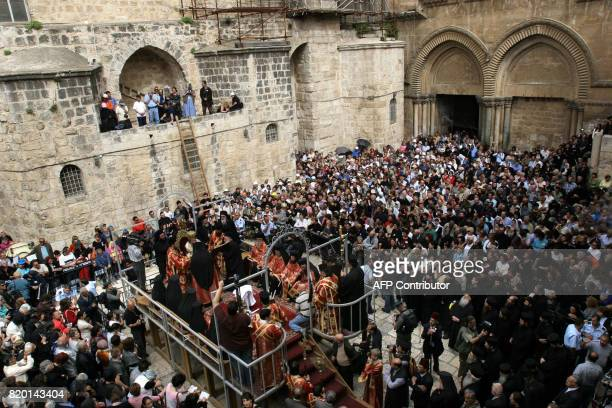 Hundreds of Chrisitian Orthodox worshippers watch the Washing of the Feet Easter ceremony lead by the Greek Orthodox Patriarch of Jerusalem...