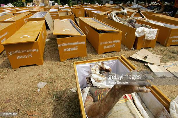 Hundreds of coffins are lined upfilled with bodies at the Ban Muang temple which has become a makeshift morgue for hundreds of bodies waiting to be...