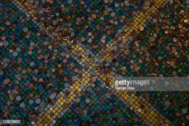 Hundreds of coins are resting at the bottom of a water fountain at the Palazzo Hotel Casino on August 12 in Las Vegas Nevada With tourism slowly...