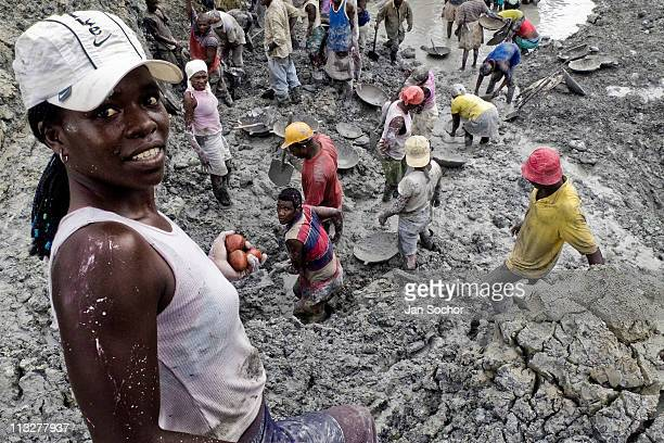 Hundreds of Colombian women dig in the mud looking for gold in the mines of Agua Clara near Tadó city on May 26 2004 in Chocó Colombia This place...