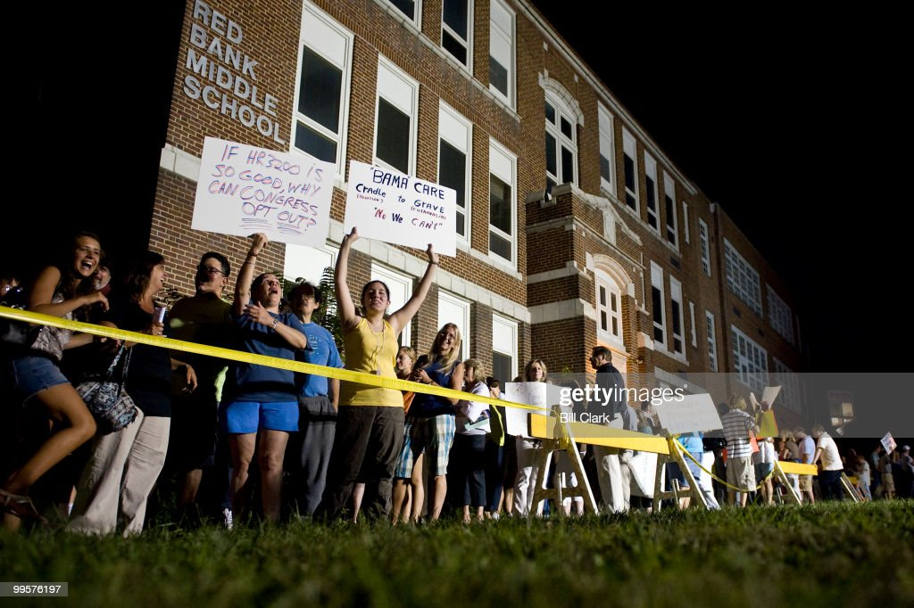 Hundreds of consituents who arrived too late to squeeze into Rep. Frank Pallone's town hall meeting at Red Bank Middle School in Red Bank, N.j., wait outside for a second session in school's auditorium on Tuesday evening, Aug. 25, 2009. Well over 1000 people showed up for the 500 person capacity auditorium forcing Rep. Pallone to do multiple town hall sessions.