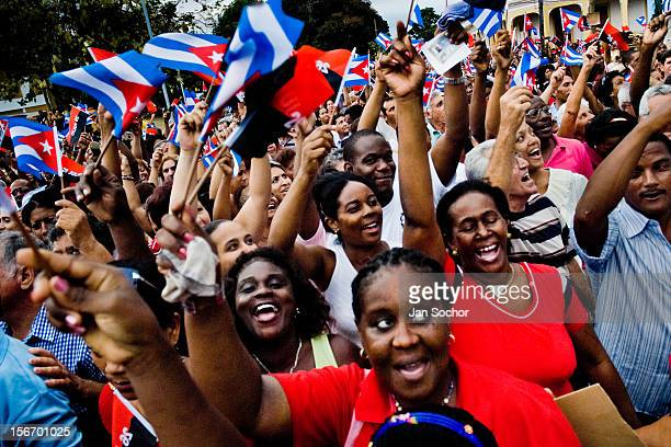 Hundreds of Cubans wave the national flags and expressing support for the regime of Fidel Castro and his brother Raul Castro during the annual...