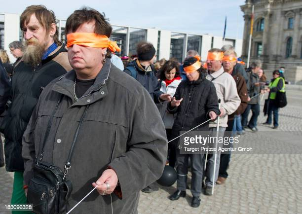 Hundreds of deaf and blind people demonstrate for more rights on October 4 2013 in Berlin Germany People disabled by both deafness and blindness...