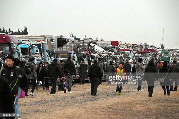 Hundreds of 'Dekotora' decoration trucks and its fans gather during the a commemorative event for late actor Bunta Sugawara at Tone River on December...