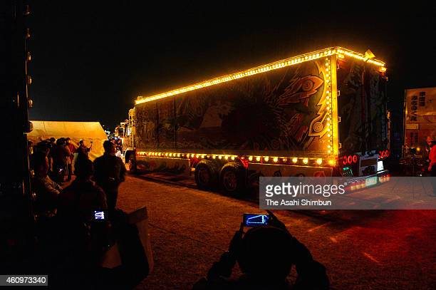 Hundreds of 'Dekotora' decoration trucks gather during the a commemorative event for late actor Bunta Sugawara at Tone River on December 31 2014 in...