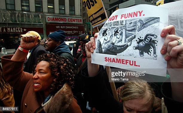 Hundreds of demonstrators gather outside New York Post headquarters to protest a controversial chimpanzee cartoon in the newspaper February 19, 2009...