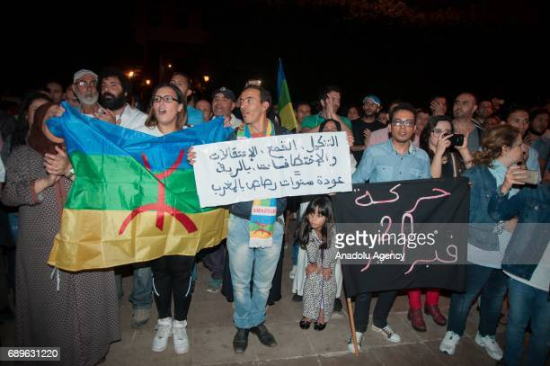 Hundreds of demonstrators hold placard as they take part in a demonstration to show their solidarity with people who were arrested at parliamentary...