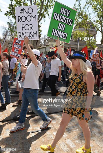 Hundreds of demonstrators hold up placards during an anti-racism rally as anti-mosque protesters stage a protest in Bendigo, a regional city in...