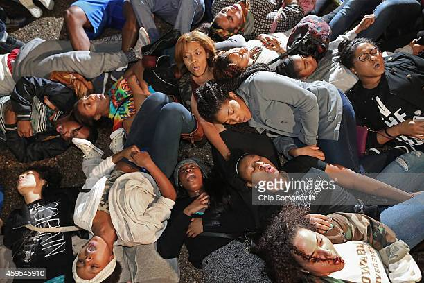 Hundreds of demonstrators many of them Howard University students lay on the ground in protest outside the White House after the Ferguson grand jury...