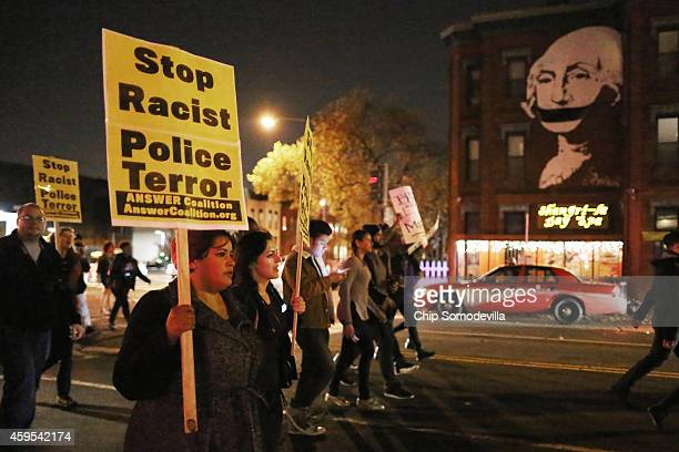 Hundreds of demonstrators many of them Howard University students march down the middle of U Street Northwest after a grand jury did not intict the...