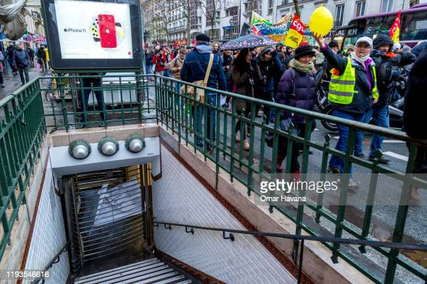 Hundreds of demonstrators march through the streets of downtown Paris where subway stations remain closed during the eighth day of a general strike...