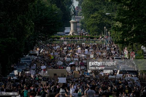 Hundreds of demonstrators march toward Lafayette Park and the White House to protest against police brutality and the death of George Floyd on June 2...