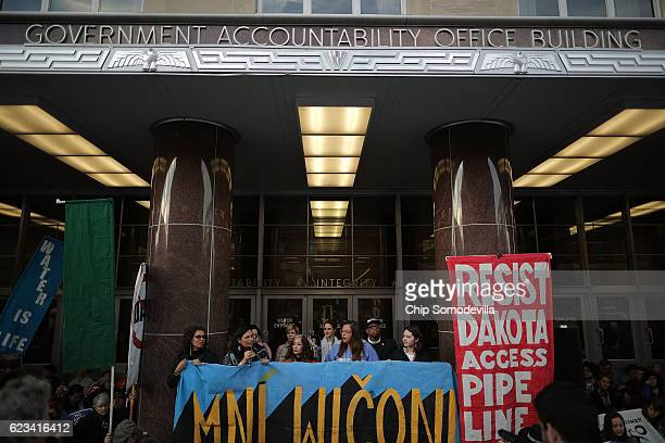Hundreds of demonstrators some traveling from North Dakota gather to protest against the proposed Dakota Access Pipeline outside the offices of the...