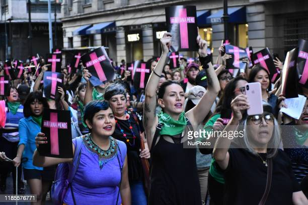 Hundreds of demonstrators take part during a protest against femicide and violence as part of International Day for the Elimination of Violence, in...