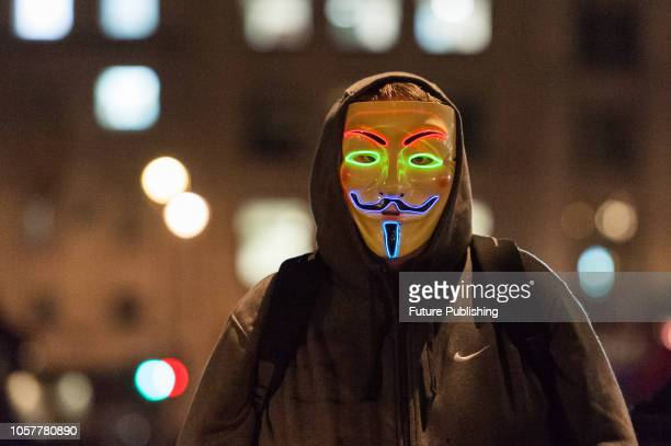 Hundreds of demonstrators wearing Guy Fawkes masks gather on Bonfire Night in London's Trafalgar Square to take part in the annual 'Million Mask...