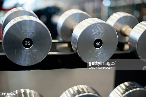 Hundreds of dumbbell weights are available for athletes to use when training at theTed Stevens Sports Services Center part of the US Olympic Training...