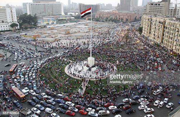 Hundreds of Egyptians gather to celebrate the opening of a new waterway at the Suez Canal on August 06 at Tahrir Square in Cairo, Egypt.