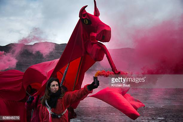 Hundreds of environmental activists stopping the open cast coal mine FfosyFran near Merthyr Tydfil Wales from operating May 3rd 2016 A red Welsh...