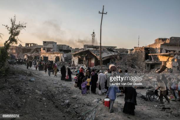 Hundreds of exhausted and panicked civilians flee Bab Sinjar, Zanjili and Abi Tamam, the 3 districts on the north side of Mosul's Old City, which is...