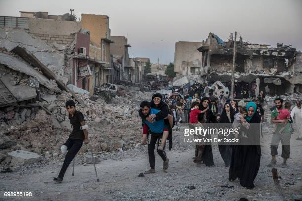 Hundreds of exhausted and panicked civilians flee Bab Sinjar Zanjili and Abi Tamam the 3 districts on the north side of Mosul's Old City which is...