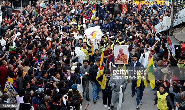 Hundreds of exiled Tibetans look on as the body of teenager Dorje Tsering is carried through the Main Square of the northern Indian town of McLeod...