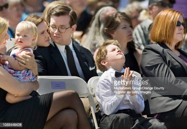 Hundreds of family and friends, including Samual Milner, front, take part in Funeral services for Crystal Cathedral founder Robert H. Schuller...