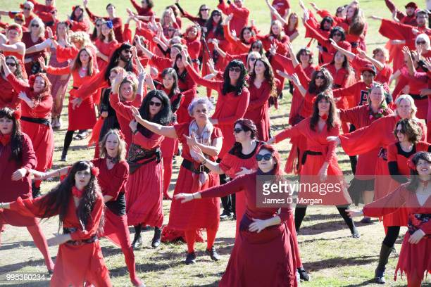 Hundreds of fans dressed as Kate Bush dance in a park on July 14, 2018 in Sydney, Australia. The Most Wuthering Heights Day is when people all around...
