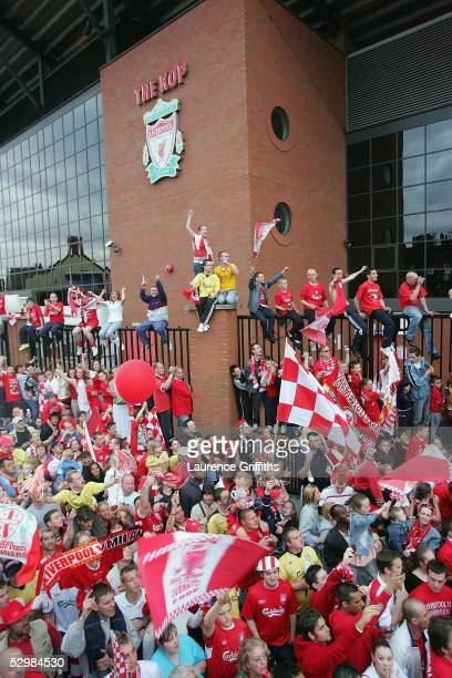 Hundreds of fans line the route as the bus goes past the Kop at Anfield during the homecoming victory parade through the streets of Liverpool on May...