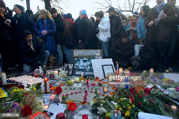 Hundreds of fans of the late Beatle John Lennon gather in the Strawberry Fields section of Central Park to memorialize the twentiethfifth anniversary...