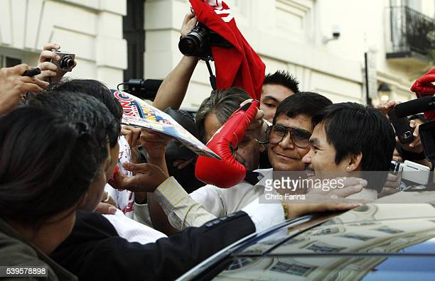 Hundreds of fans surround fourtime world champion Manny Pacman PacquiaoGeneral Santos Philippines as he arrives at the Philippine Embassy in...