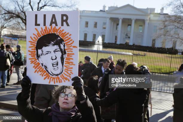 Hundreds of federal workers and contractors rally against the partial federal government shutdown in front of the White House January 10 2019 in...