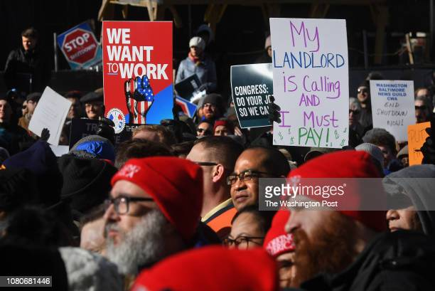 JAN Hundreds of federal workers rallied and listened to speakers at the headquarters of the AFLCIO before they marched to an area in front of the...